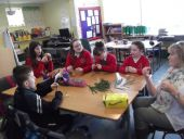 Some pupils from Mr Tracey's class making Saint Brigid crosses